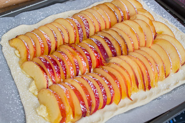 the peach slices over the cream overlapping slightly brush the peaches ...